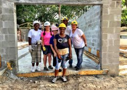 "Habitat Hillsborough homeowner candidate Rhonda Barr (center) celebrates with fellow homeowner candidates and Kathy Brogli, VP of Homeowner Services, as they prepare to ""raise the roof"" on the new Barr family residence in Tampa."