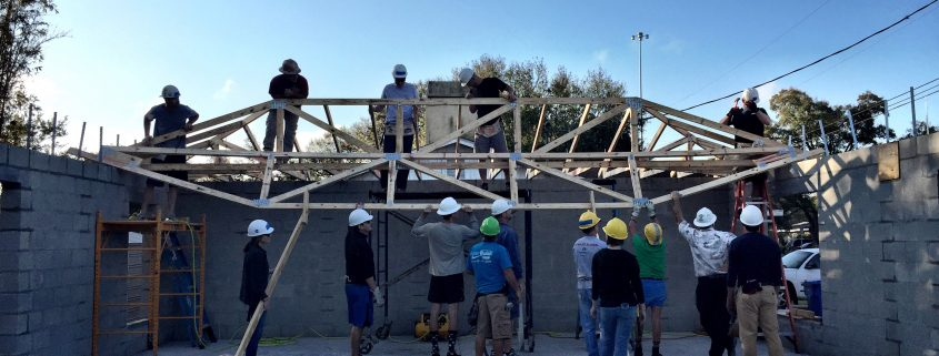 Work Teams 'Raise the Roof' on Two More Homes