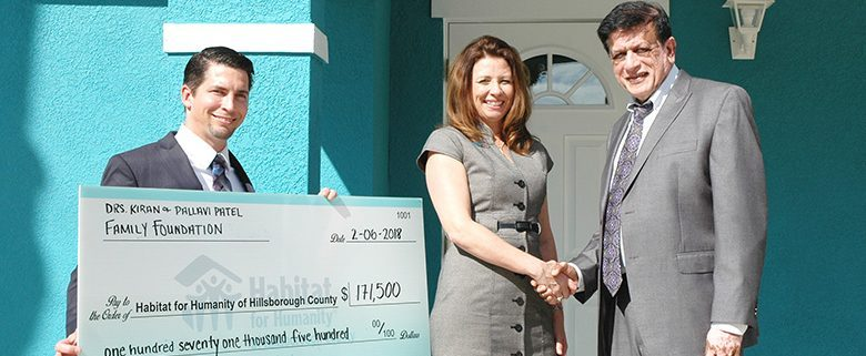 Patel Family Foundation presents $171,500 check to build 2 Habitat homes